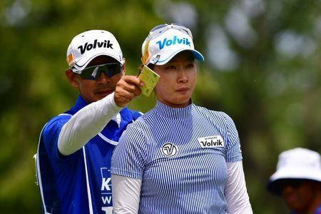 Jun 29, 2017; Olympia Fields, IL, USA; Chella Choi talks to her caddy before teeing off on the eighteenth hole during the first round of the KPMG Women's PGA Championship golf tournament at Olympia Fields Country Club - North. Thomas J. Russo-USA TODAY Sports
