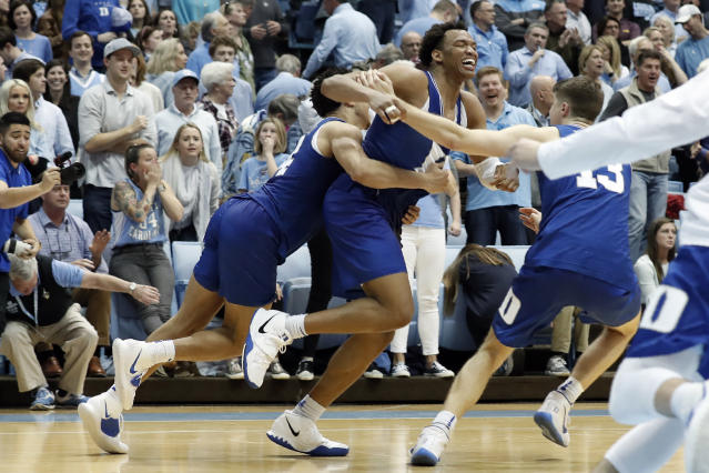 Duke forward Wendell Moore celebrates his game-winning shot in overtime against North Carolina. (AP Photo/Gerry Broome)