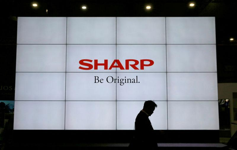 FILE PHOTO: A logo of Sharp Corp is pictured at the CEATEC JAPAN 2017 in Chiba