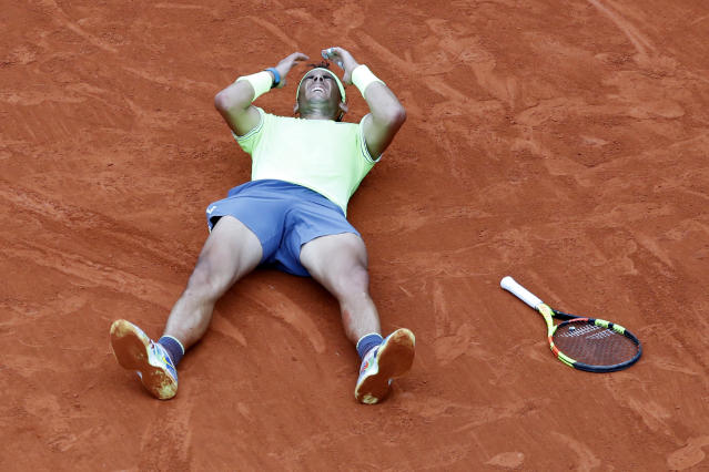 Spain's Rafael Nadal lays on the clays as he defeats Austria's Dominic Thiem during the men's final match of the French Open tennis tournament at the Roland Garros stadium in Paris, Sunday, June 9, 2019. Nadal won 6-3, 5-7, 6-1, 6-1. (AP Photo/Pavel Golovkin)