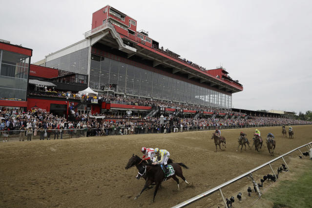 FILE - In this May 20, 2017, file photo, Cloud Computing (2), ridden by Javier Castellano, left, wins 142nd Preakness Stakes horse race at Pimlico race course as Classic Empire (5) with Julien Leparoux aboard takes second, in Baltimore. An engineering firm has determined the last historic section of Pimlico Race Course isn't safe, meaning almost 7,000 seats won't be available for the Preakness Stakes next month. The Baltimore Sun reports the Maryland Jockey Club will hold a news conference Monday, April 15, 2019, about the closure of 6,670 seats in the Old Grandstand's open-air section.(AP Photo/Matt Slocum)