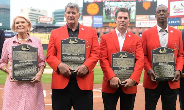 St. Louis Cardinals Hall of Fame inductees or their representatives, from left, Martina Dill, representing her father, Marty Marion; Mike Shannon; Jim Edmonds; and Willie McGee are introduced prior to the Cardinals' baseball game against the San Diego Padres, Saturday, Aug. 16, 2014, at Busch Stadium in St. Louis. (AP Photo/Bill Boyce)