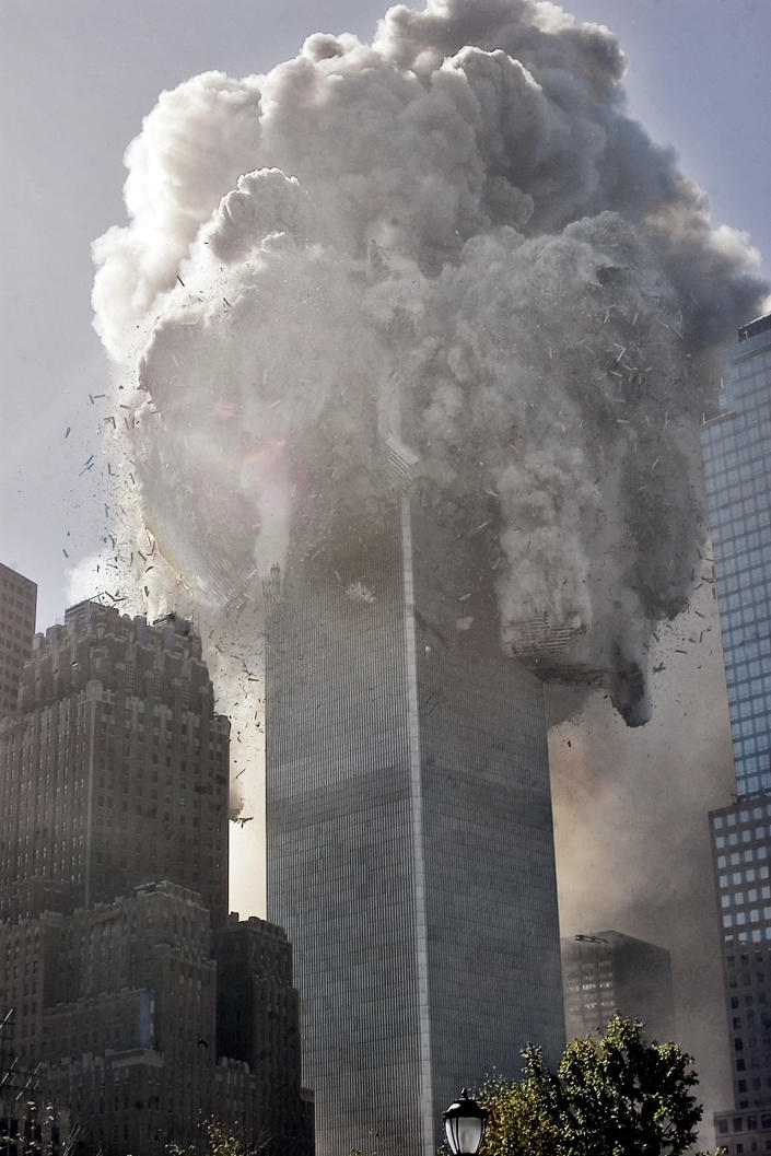"""The north tower of New York's World Trade Center collapses after being struck by hijacked American Airlines Flt. 11, Tuesday, Sept. 11, 2001. <br><br>(AP Photo Richard Drew)<br><a href=""""http://www.life.com/gallery/59971/911-the-25-most-powerful-photos#index/0"""" rel=""""nofollow noopener"""" target=""""_blank"""" data-ylk=""""slk:"""" class=""""link rapid-noclick-resp""""><br></a>"""