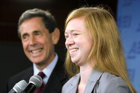 Fisher and Blum smile at a news conference in Washington