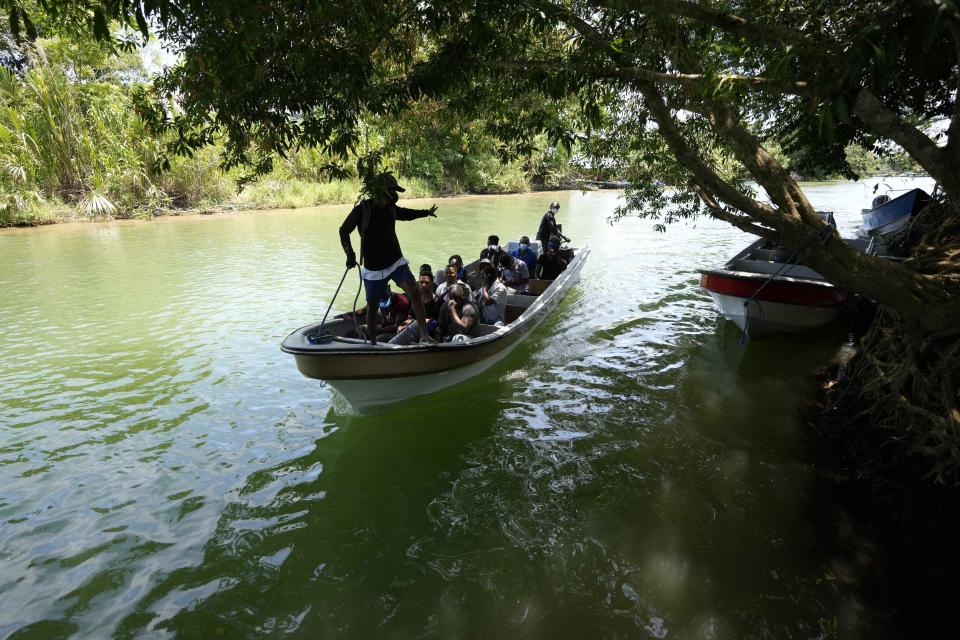 Migrants arrive on a boat to Acandi, Colombia, Tuesday, Sept. 14, 2021. (AP Photo/Fernando Vergara)