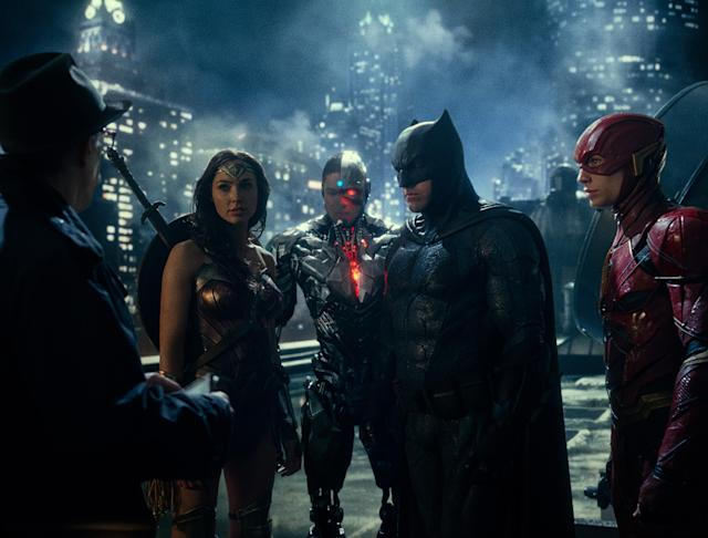 The Justice League has a rooftop meeting with James Gordon in <em>Justice League.</em> (Photo: Warner Bros.)