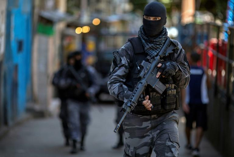 Heavily armed police often carry out operations in the poorer neighborhoods of Brazil, as shown in this 2018 photo from Rio de Janeiro