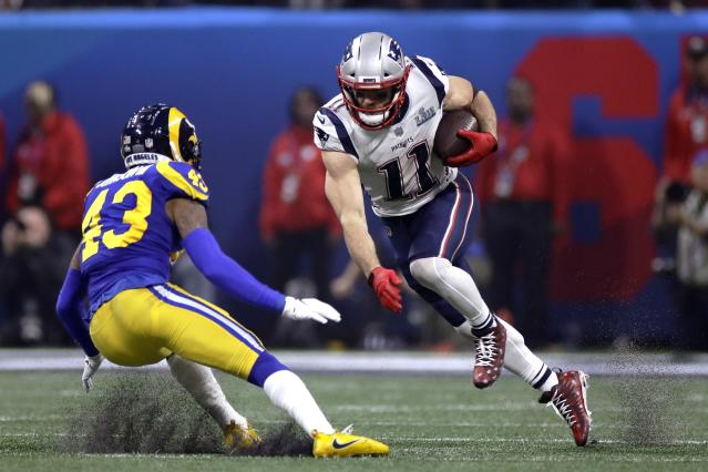 <p>New England Patriots' Julian Edelman, right, tries to elude Los Angeles Rams' John Johnson III (43) after catching a pass during the second half of the NFL Super Bowl 53 football game Sunday, Feb. 3, 2019, in Atlanta. (AP Photo/Carolyn Kaster) </p>