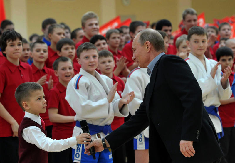 Russian President Vladimir Putin, right, visits a new sports arena in Moscow, Wednesday, March 13, 2013. President Vladimir Putin has called for the revival of the Soviet-era physical evaluation program that required all schoolchildren to pass fitness tests. (AP Photo/RIA-Novosti, Alexei Nikolsky, Presidential Press Service)
