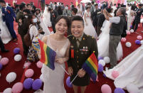 Lesbian couple Yi Wang, right, and Yumi Meng pose during a military mass weddings ceremony in Taoyuan city, northern Taiwan, Friday, Oct. 30, 2020. Two lesbian couples tied the knot in a mass ceremony held by Taiwan's military on Friday in a historic step for the island. Taiwan is the only place in Asia to have legalized gay marriage, passing legislation in this regard in May 2019.(AP Photo/Chiang Ying-ying)