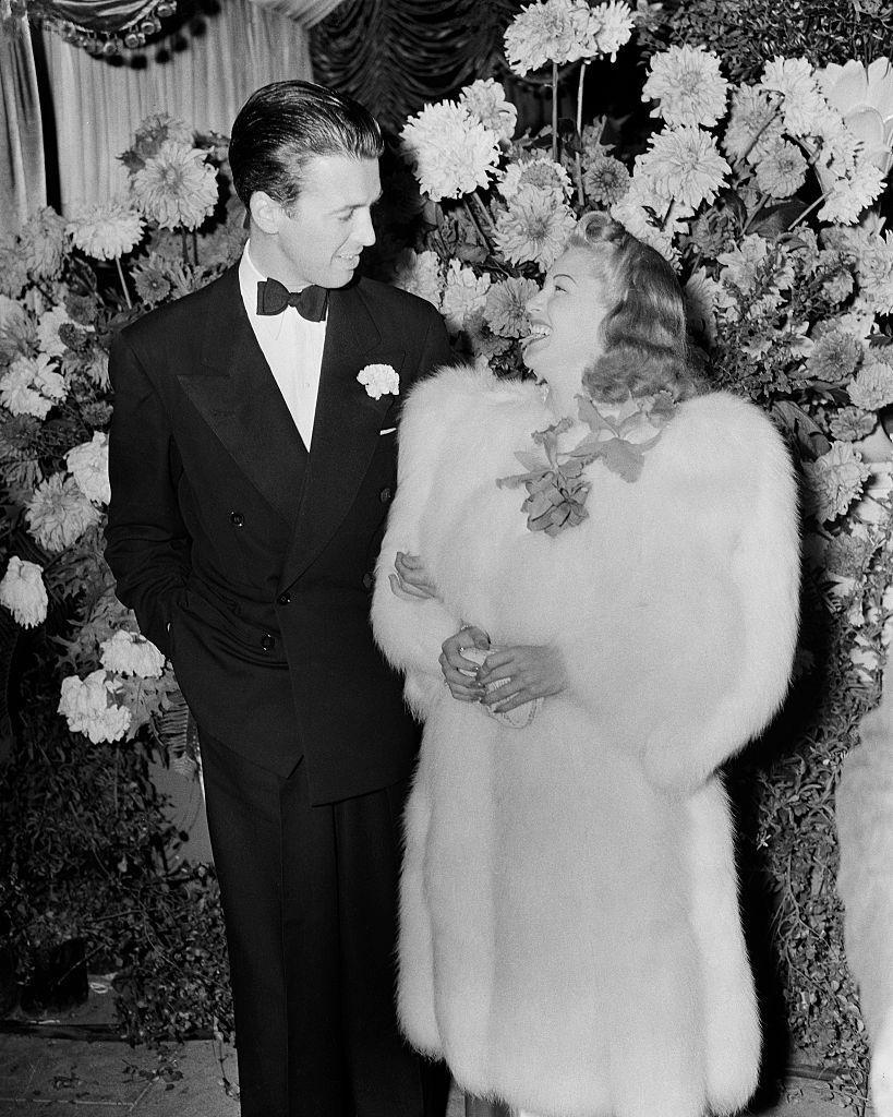 <p>Actor Jimmy Stewart and actress Lana Turner share a smile at the Los Angeles film premiere of <em>The Women</em>, circa 1939.</p>