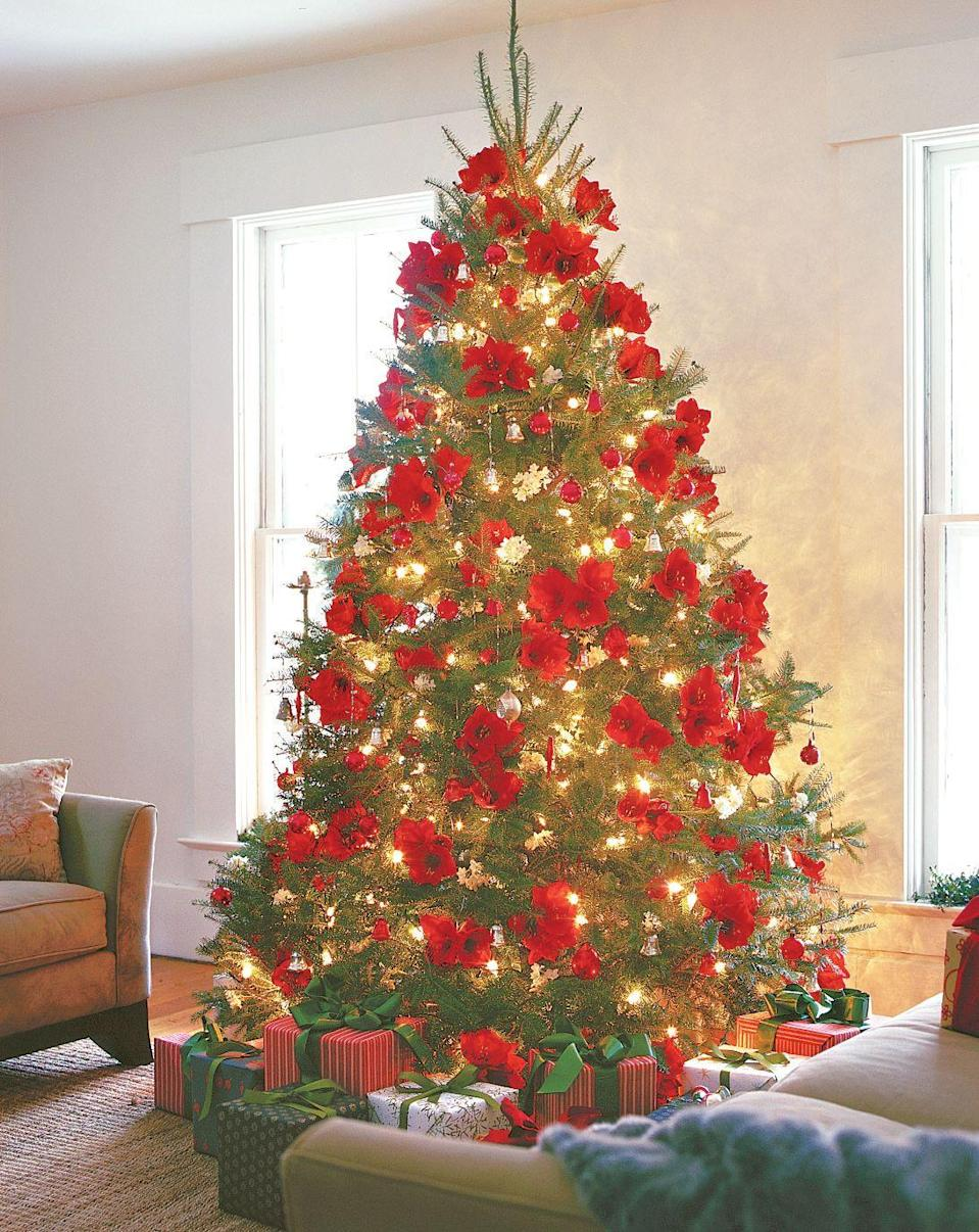 """<p>Give your ornament collection a break this year and go for this stunning tree look, featuring striking red flowers. </p><p><a class=""""link rapid-noclick-resp"""" href=""""https://go.redirectingat.com?id=74968X1596630&url=https%3A%2F%2Fwww.etsy.com%2Flisting%2F546552780%2Fset-of-5-dark-pink-or-red-orchid-flowers&sref=https%3A%2F%2Fwww.goodhousekeeping.com%2Fholidays%2Fchristmas-ideas%2Fg2707%2Fdecorated-christmas-trees%2F"""" rel=""""nofollow noopener"""" target=""""_blank"""" data-ylk=""""slk:SHOP ARTIFICIAL FLOWERS"""">SHOP ARTIFICIAL FLOWERS</a></p>"""