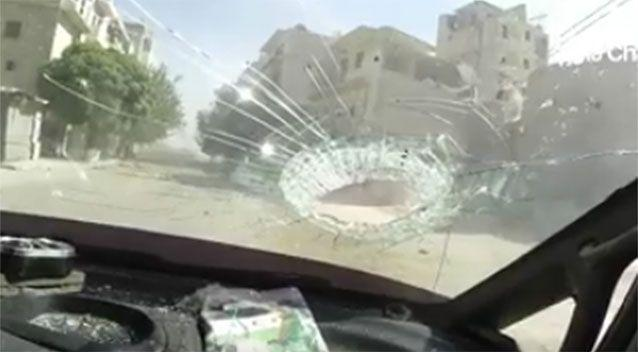 A large piece of debris leaves a significant hole in the windshield of the vechicle. Source: Syria Charity/Facebook.