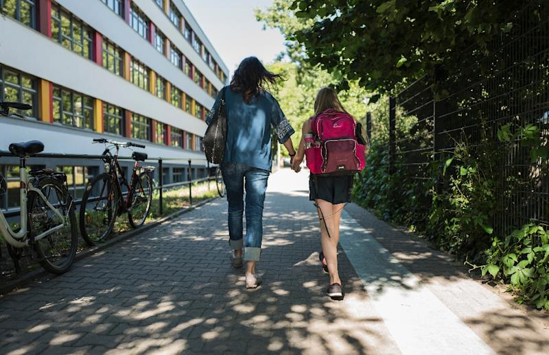 The notion that children's well-being depends on their mothers and not on the society around them or their fathers, is deeply entrenched in Germany and creates real obstacles to women's careers (AFP Photo/John Macdougall)