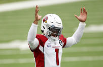 Arizona Cardinals quarterback Kyler Murray (1) reacts after a touchdown against the New York Jets during an NFL football game, Sunday, Oct. 11, 2020, in East Rutherford, N.J. With the NFC East a total mess, the conference's West Division is so strong that three teams, possibly all four, figure to challenge for the playoffs.(AP Photo/Adam Hunger)