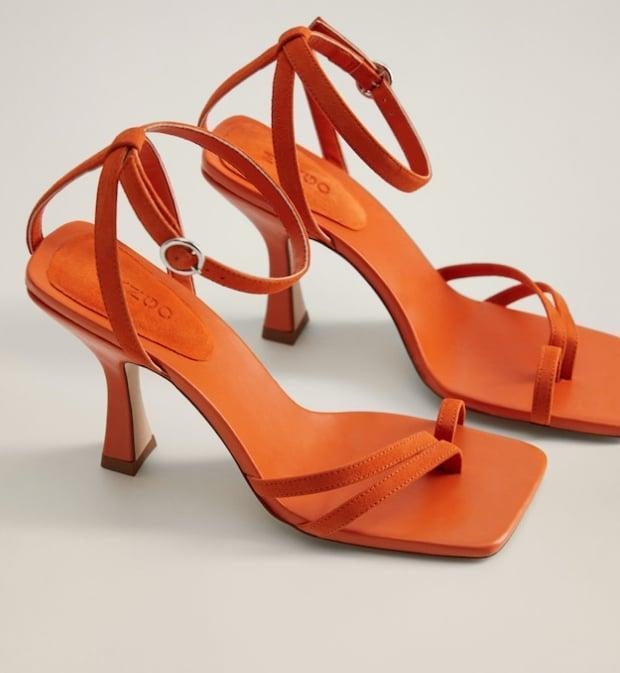 "<p>These would be perfect with a wide-leg trouser and crop top.</p> <p><a href=""https://www.popsugar.com/buy/Mango-Asymmetric-Leather-Sandals-573338?p_name=Mango%20Asymmetric%20Leather%20Sandals&retailer=shop.mango.com&pid=573338&price=120&evar1=fab%3Aus&evar9=47446893&evar98=https%3A%2F%2Fwww.popsugar.com%2Ffashion%2Fphoto-gallery%2F47446893%2Fimage%2F47463419%2FMango-Asymmetric-Leather-Sandals&list1=sandals%2Cshoes%2Ctrends%2Csummer%2Cfashion%20shopping&prop13=api&pdata=1"" class=""link rapid-noclick-resp"" rel=""nofollow noopener"" target=""_blank"" data-ylk=""slk:Mango Asymmetric Leather Sandals"">Mango Asymmetric Leather Sandals</a> ($120)</p>"