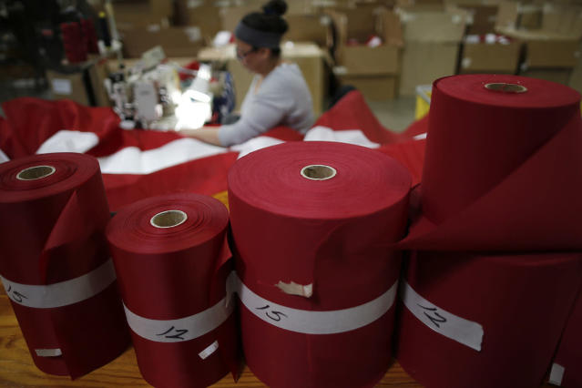 <p>Rolls of red fabric sit as a worker sews an American flag at the FlagSource facility in Batavia, Illinois, U.S., on Tuesday, June 27, 2017. (Photo: Jim Young/Bloomberg via Getty Images) </p>