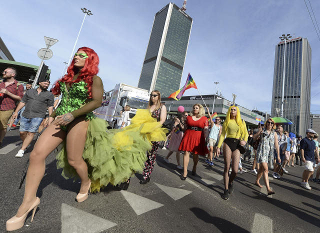<p>People dressed in drag, take part in the annual gay pride parade in Warsaw, Poland, Saturday, June 9, 2018. The pride celebrations come as LGBT activists say a conservative turn in Poland is only motivating them to fight harder for their rights, even though their hopes of seeing same-sex marriage legalized has no chance now in the country. (Photo: Czarek Sokolowski/AP) </p>