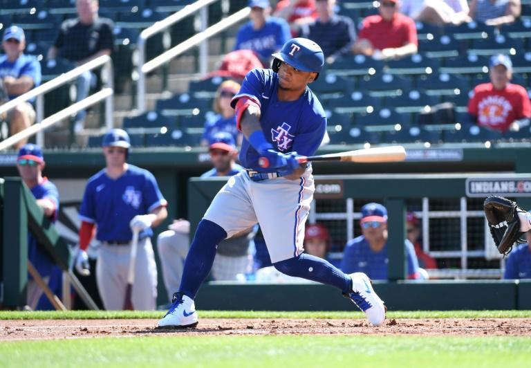 Texas Rangers outfielder Willie Calhoun was taken to the hospital after being hit by a fastball in the first inning against the Los Angeles Dodgers on Sunday in suburban Phoenix, Arizona (AFP Photo/Norm Hall)