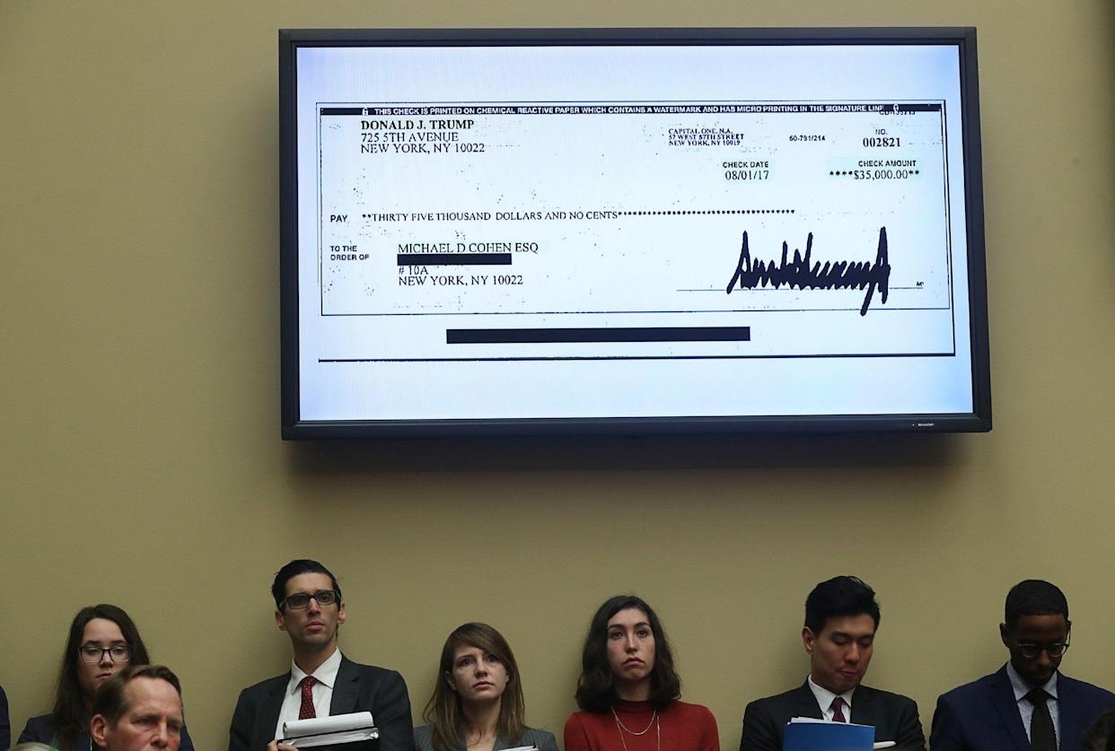 A $35,000 check signed by President Trump to Michael Cohen is shown on a television monitor inside the hearing room as Cohen testifies on Feb. 27. (Photo: Jonathan Ernst/Reuters)