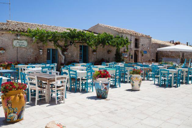 Marzamemi, Italy - July 27, 2015: Marzamemi Fishermen village in Sicily, photo taken in the main square of Marzamemi at noon, no people in the scene. (Photo: Angelafoto via Getty Images)