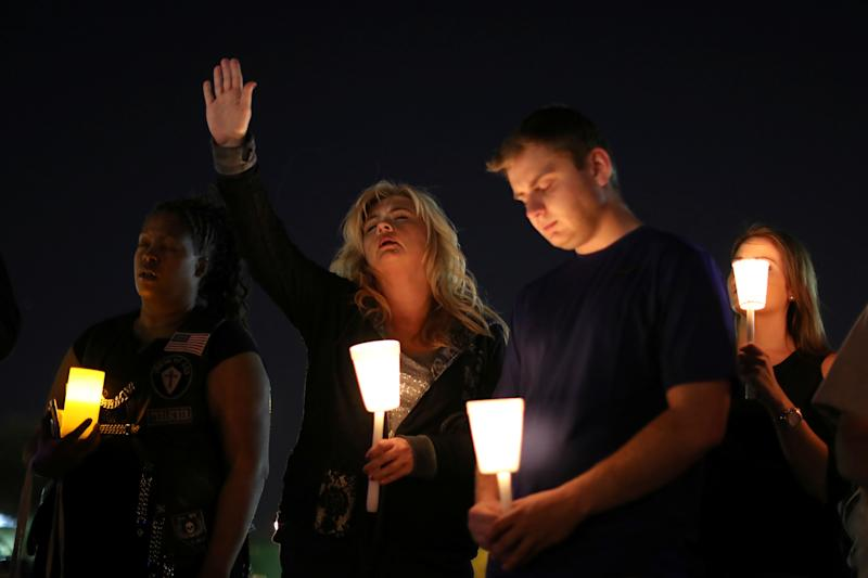 People pray during a candlelight vigil for victims of the Route 91 music festival mass shooting next to the Mandalay Bay Resort and Casino in Las Vegas, Nevada, U.S. October 3, 2017.  (Lucy Nicholson / Reuters)