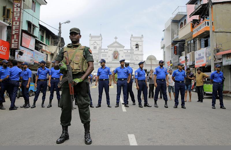 Sri Lankan Army soldiers secure the area around St. Anthony's Shrine after a blast in Colombo, Sri Lanka, Sunday, April 21, 2019. Witnesses are reporting two explosions have hit two churches in Sri Lanka on Easter Sunday, causing casualties among worshippers. (AP Photo/Eranga Jayawardena)