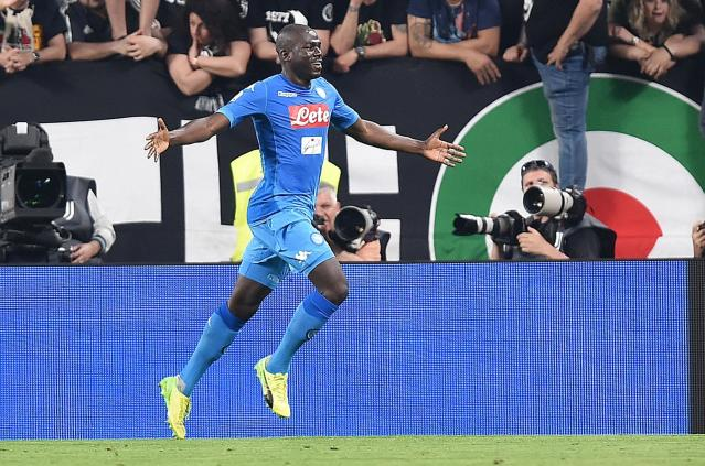 Napoli's kaliodou Koulibaly celebrates after scoring during a Serie A soccer match between Juventus and Napoli at the Allianz Stadium in Turin, Italy, Sunday, April 22, 2018. (Alessandro Di Marco/ANSA via AP)