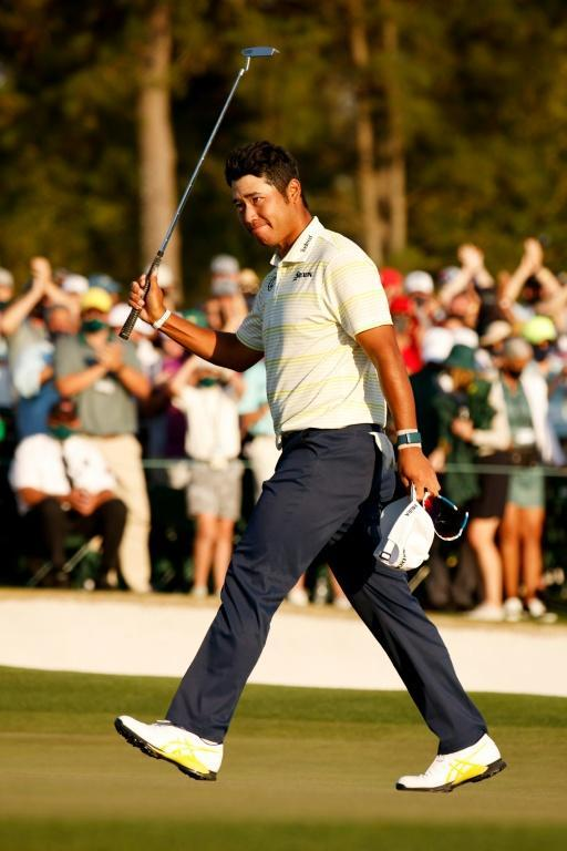 Hideki Matsuyama of Japan celebrates on the 18th green after clinching his Masters victory