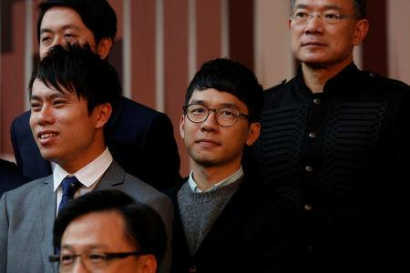 Pro-democracy lawmaker Nathan Law poses for an official group photo with fellow lawmakers at the Legislative Council in Hong Kong November 29, 2016.    REUTERS/Bobby Yip