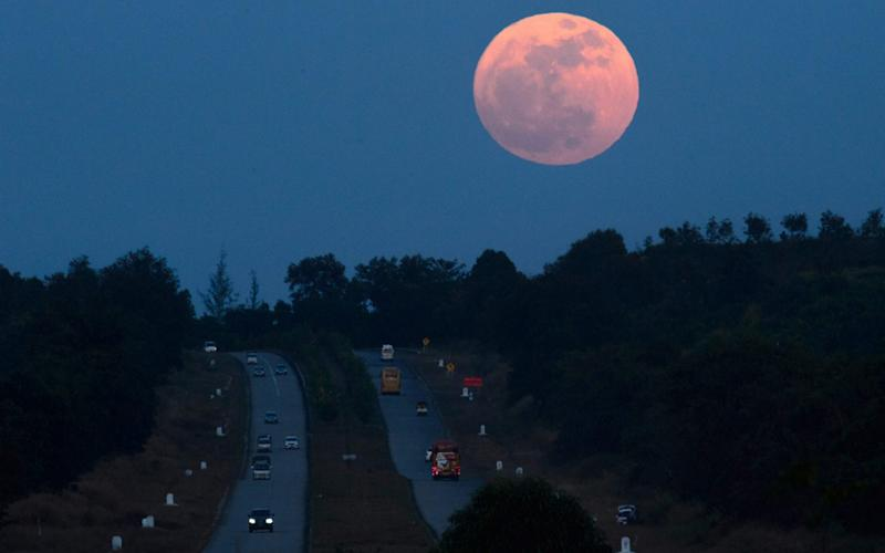 Dazzling: supermoons only occur a few times each year - AFP