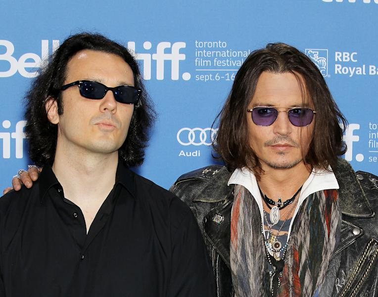 """This image released by Starpix shows Damien Echols, one of the West Memphis Three, left, and actor Johnny Depp at a press conference for the film """"West of Memphis"""" at the 2012 Toronto International Film Festival in Toronto on Saturday, Sept. 8, 2012. (AP Photo/Starpix, Marion Curtis)"""
