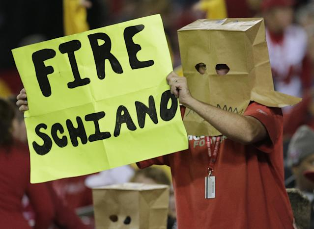 A Tampa Bay Buccaneers fan, wearing a paper bag, holds up a sign during the fourth quarter of an NFL football game against the Carolina Panthers, Thursday, Oct. 24, 2013, in Tampa, Fla. (AP Photo/Chris O'Meara)