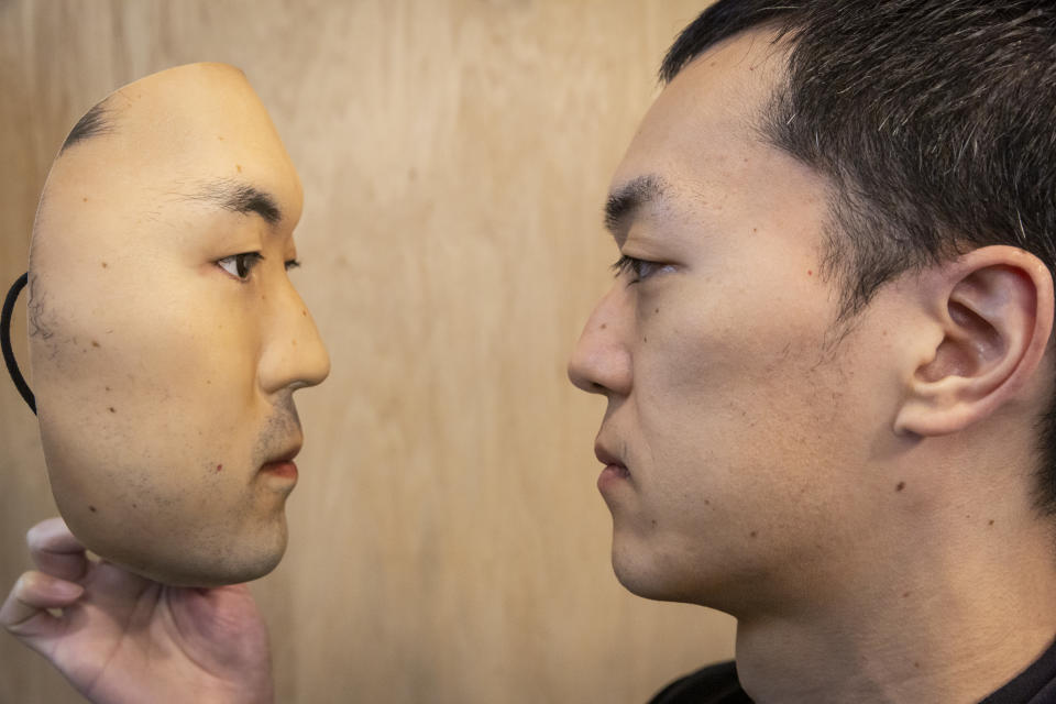 TOKYO, JAPAN - JANUARY 28: Shuhei Okawara, owner of mask shop Kamenya Omote, holding Hyper-realistic face mask poses for a portrait  on January 28, 2021 in Tokyo, Japan. The masks, made by Japanese retailer Kamenya Omote, are modelled on actual people who are paid 40,000 Yen for the right to use their face and are created on a 3D printer before being sold for up to 98,000 Yen. Although providing quite a party piece, unfortunately they don't offer protection from coronavirus. (Photo by Yuichi Yamazaki/Getty Images)