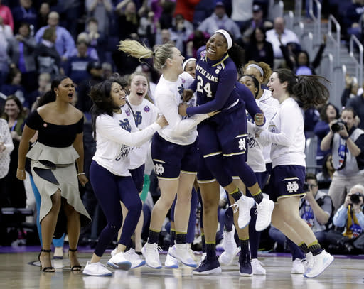 Notre Dame's Arike Ogunbowale (24) celebrates after making the game-winning basket to defeat Connecticut in overtime in the semifinals of the women's NCAA Final Four college basketball tournament, Friday, March 30, 2018, in Columbus, Ohio. Notre Dame won 91-89. (AP Photo/Ron Schwane)
