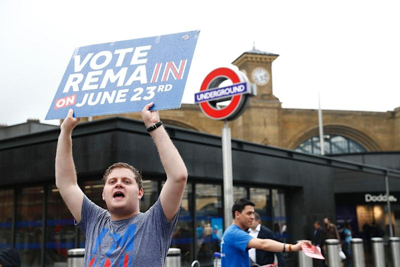 "A ""Vote Remain"" activist urges people to vote outside Kings Cross station in central London on June 23, 2016"
