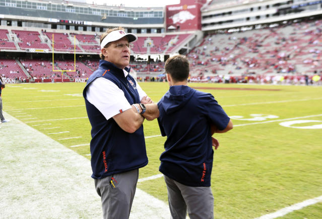 Auburn coach Gus Malzahn watches as the final seconds run off the clock against Arkansas in the second half of an NCAA college football game, Saturday, Oct. 19, 2019 in Fayetteville, Ark. (AP Photo/Michael Woods)