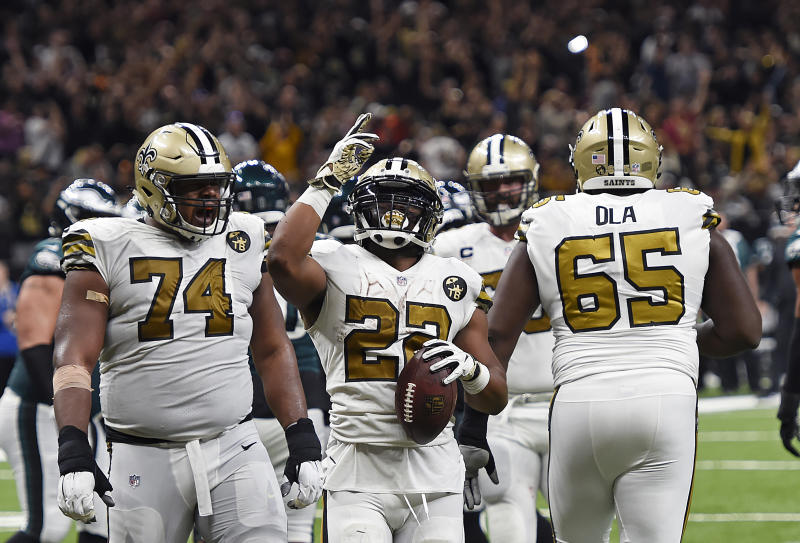 New Orleans Saints running back Mark Ingram (22) celebrates a touchdown against the Eagles. (AP)