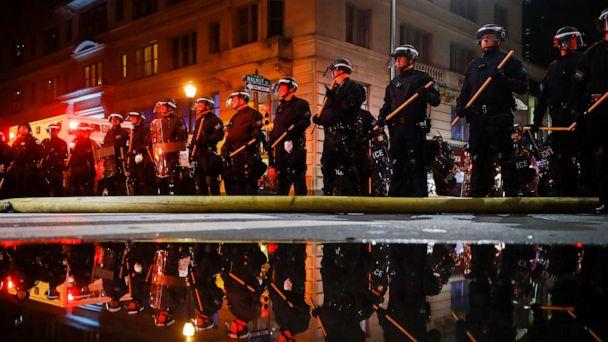 PHOTO: Police are reflected as they stand guard, May 30, 2020, in Philadelphia, during a protest over the death of George Floyd. (Matt Rourke/AP)