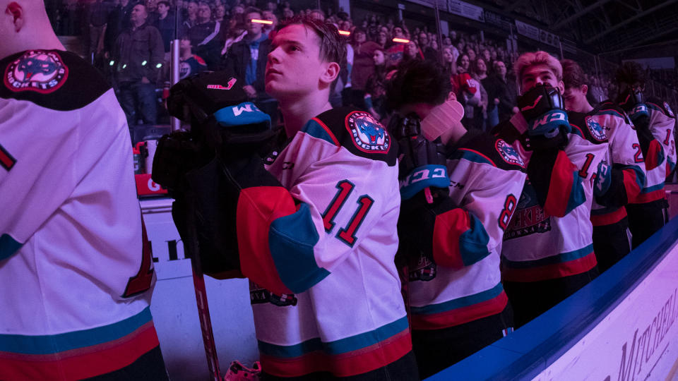 KELOWNA, BC - MARCH 7: Pavel Novak #11 of the Kelowna Rockets stands on the bench for the national anthem against the Lethbridge Hurricanes at Prospera Place on March 7, 2020 in Kelowna, Canada. (Photo by Marissa Baecker/Getty Images )