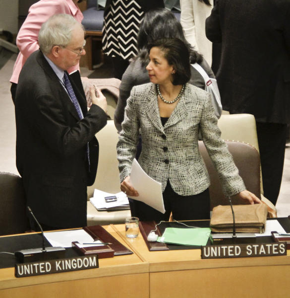 U.K. Ambassador Mark Lyall, left, and U.S. Ambassador Susan Rice confer before members of the United Nations Security Council vote for tough new sanctions against North Korea for its latest nuclear test, during a meeting at U.N. headquarters Thursday, March 7, 2013. The unanimous vote by the U.N.'s most powerful body sparked a furious Pyongyang to threaten a nuclear strike against the United States. (AP Photo/Bebeto Matthews)