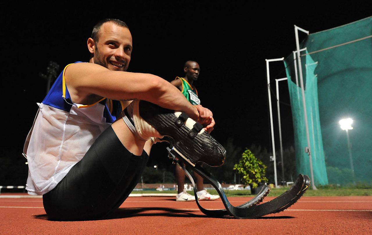 DURBAN, SOUTH AFRICA - MARCH 27: Oscar Pistorius looks on during day 3 of the 2012 Nedbank National Championships for the Physically Disabled at the Athletics Stadium on March 27, 2012 in Durban, South Africa.  (Photo by Duif du Toit/Gallo Images/Getty Images)