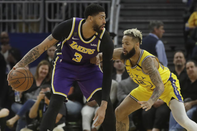 Los Angeles Lakers forward Anthony Davis (3) is defended by Golden State Warriors guard Ky Bowman (12) during the second half of an NBA basketball game in San Francisco, Thursday, Feb. 27, 2020. (AP Photo/Jeff Chiu)