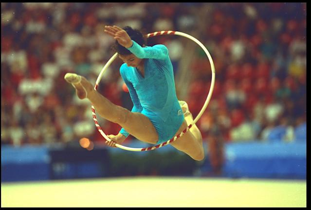8 AUG 1992: CHRISTIANE KLUMP OF GERMANY PERFORMS HER ROUTINE WITH THE HOOP DURING THE RHYTHMIC ALL-AROUND COMPETITION AT THE 1992 BARCELONA OLYMPICS.