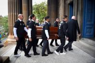 Pallbearers, wearing a number two shirt with Ricksen's name written on them, carry the coffin of the former Dutch footballer (Photo by Andy Buchanan / AFP)