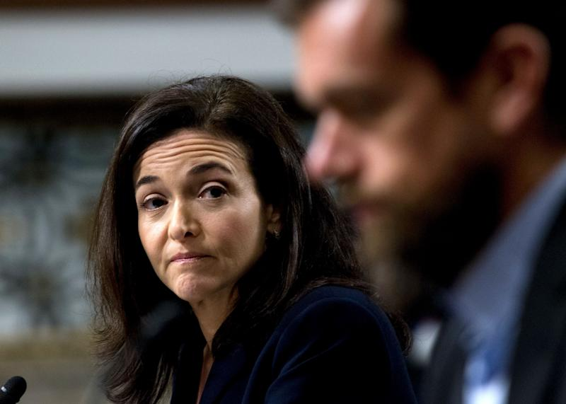 Facebook COO Sheryl Sandberg accompanied by Twitter CEO Jack Dorsey, right, before the Senate Intelligence Committee hearing on 'Foreign Influence Operations and Their Use of Social Media Platforms' on Capitol Hill, Wednesday, Sept. 5, 2018, in Washington. Google CEO did not show for the hearing. (AP Photo/Jose Luis Magana)