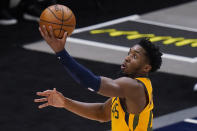 Utah Jazz guard Donovan Mitchell lays the ball up during the first half of the team's NBA basketball game against the New Orleans Pelicans Tuesday, Jan. 19, 2021, in Salt Lake City. (AP Photo/Rick Bowmer)