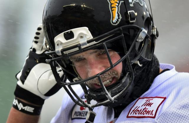 Hamilton Tiger-Cats wide receiver Andy Fantuz catches his breath during practice in Regina, Saskatchewan, Wednesday Nov. 20, 2013. Hamilton and the Saskatchewan Roughriders will face off in the 101st Grey Cup on Sunday. (AP Photo/The Canadian Press, Paul Chiasson)