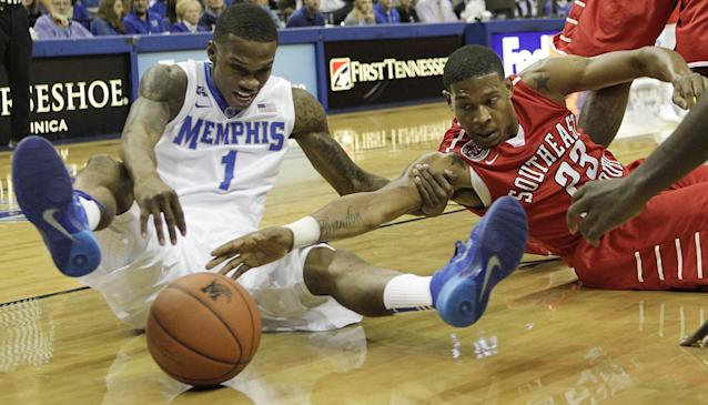 Memphis guard Joe Jackson (1) battles for a loose ball against Southeast Missouri guard Jarekious Bradley (23) in the first half of an NCAA college basketball game on Saturday, Dec. 21, 2013, in Memphis, Tenn. (AP Photo/Lance Murphey)