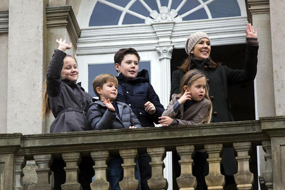 <p>November 2017: Mary and her grown up children watch the annual Hubertus Hunt from their palace balcony. Photo: Getty Images.</p>